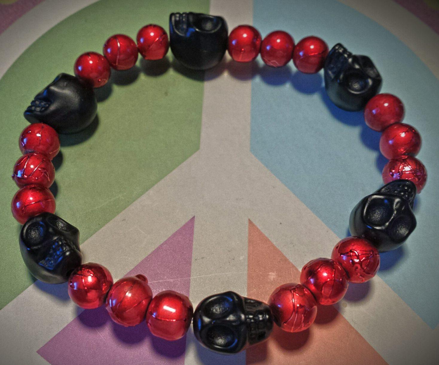 black skulls red beads